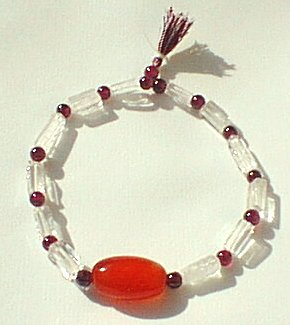 Design 583: red garnet stretch bracelets