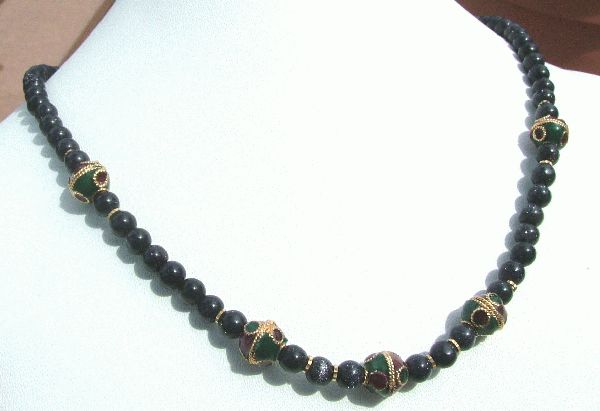 Design 1190: black,blue,gold,green,red goldstone necklaces