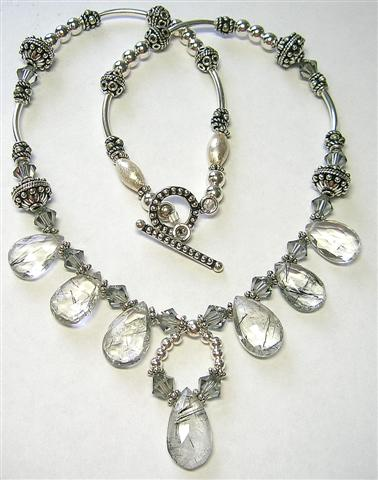 Design 5600: white rutilated drop necklaces