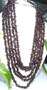 Design 7183: red garnet chipped, multistrand necklaces