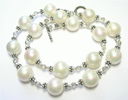Design 7390: white pearl necklaces