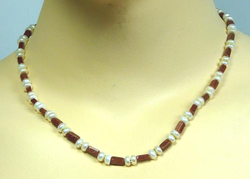 Design 7400: white pearl necklaces