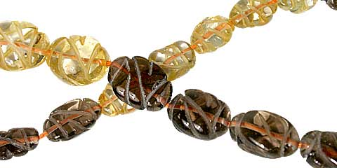 Design 11766: brown,yellow citrine carved, oval beads