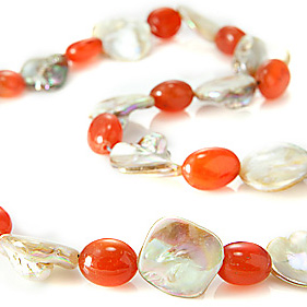 Design 21215: orange,white mother-of-pearl necklaces